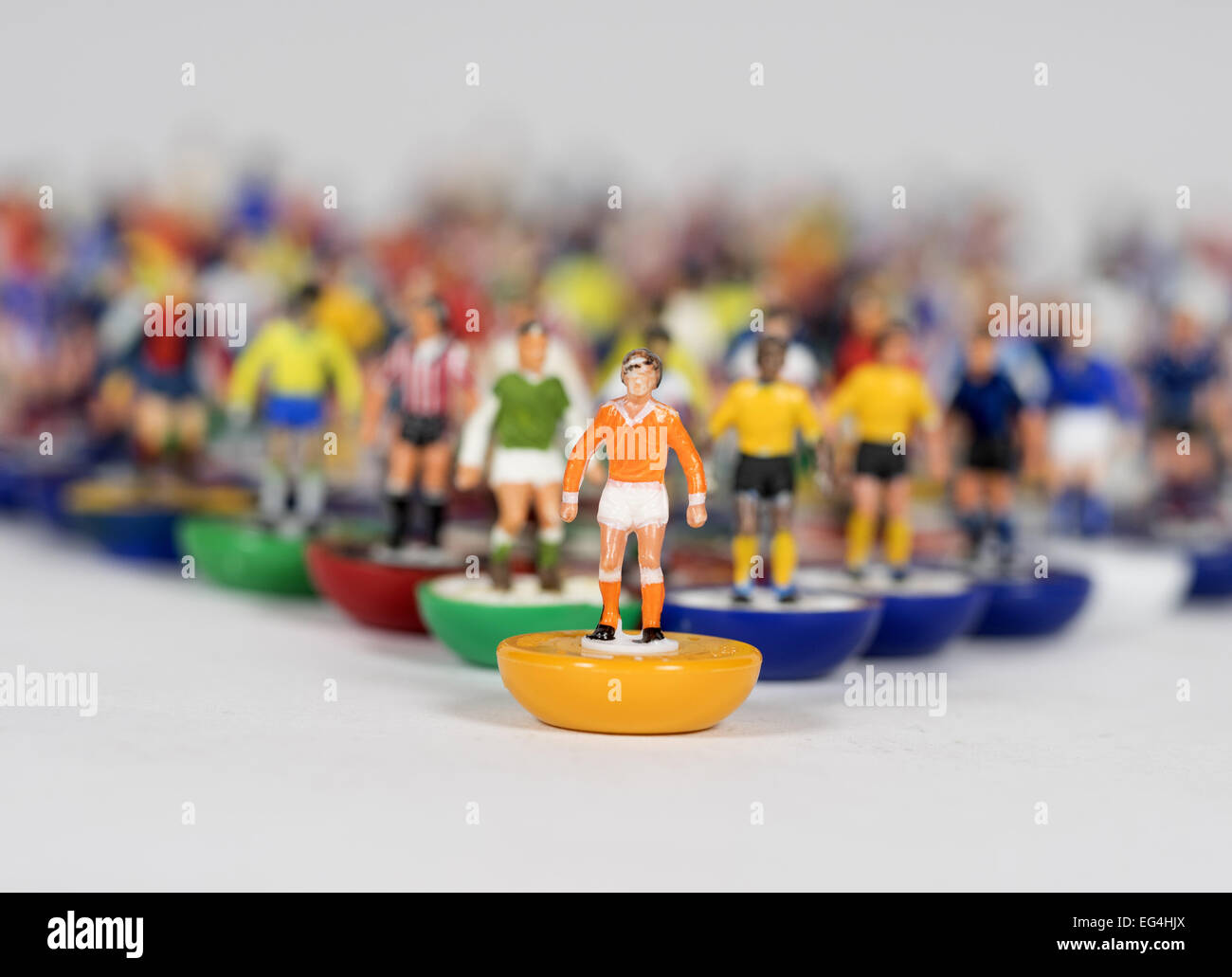 A mixture of individual subbuteo table football figures of different teams with Blackpool colours at the front - Stock Image
