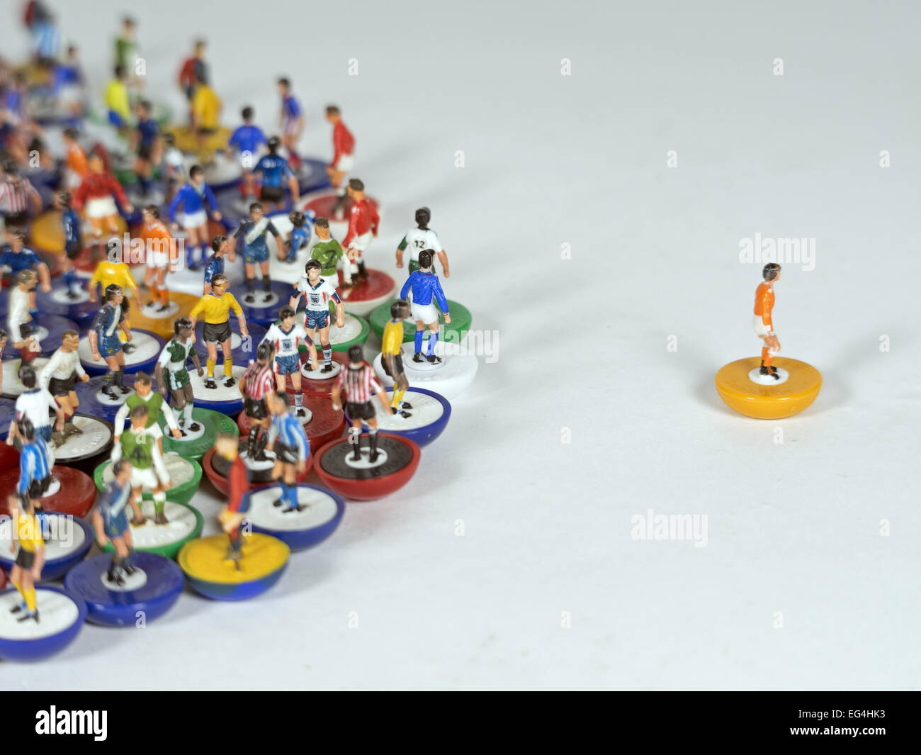A mixture of individual subbuteo table football figures of different teams - Stock Image