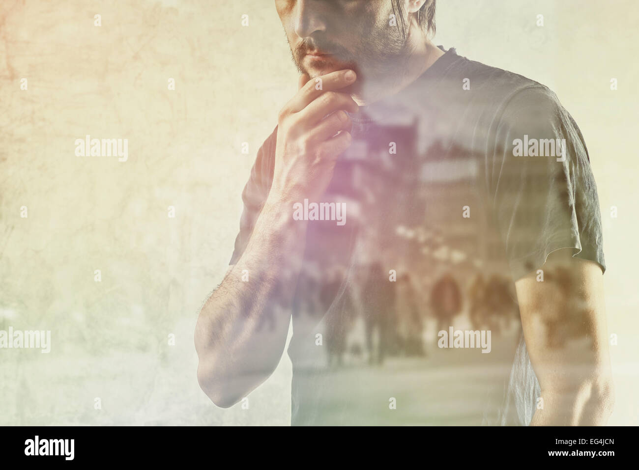 Conceptual Composite Image of Adult Lonely Man Remembering Something from his Past, Hand on Chin. - Stock Image