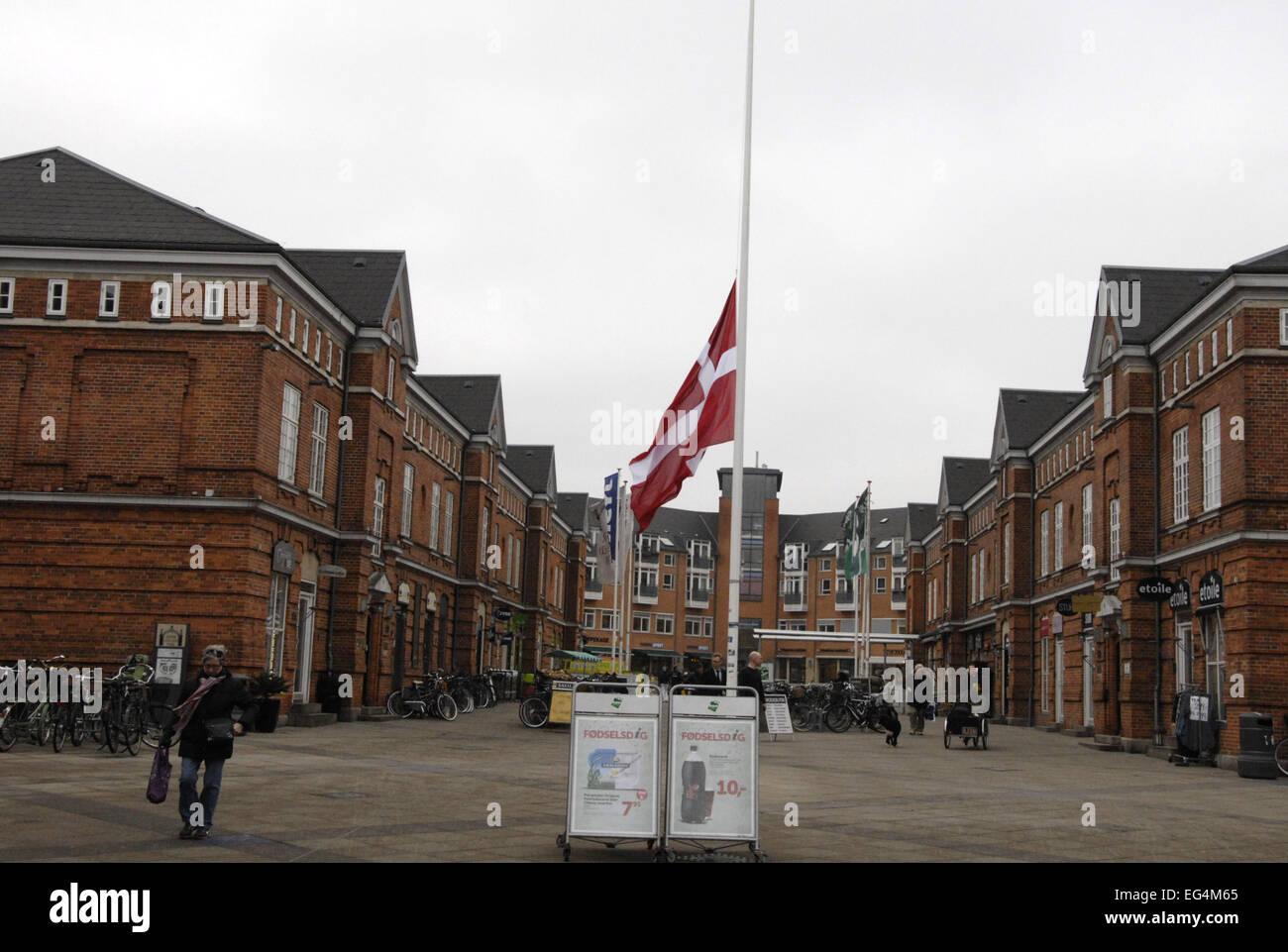 Copenhagen, Denmark. 16th February, 2015. Dannebrog/Danish flag at half mast on official buildings, ministries, - Stock Image