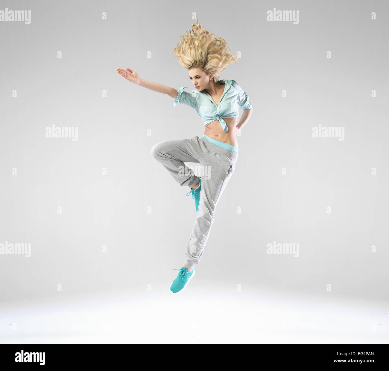 Blonde cheerful lady during the training - Stock Image