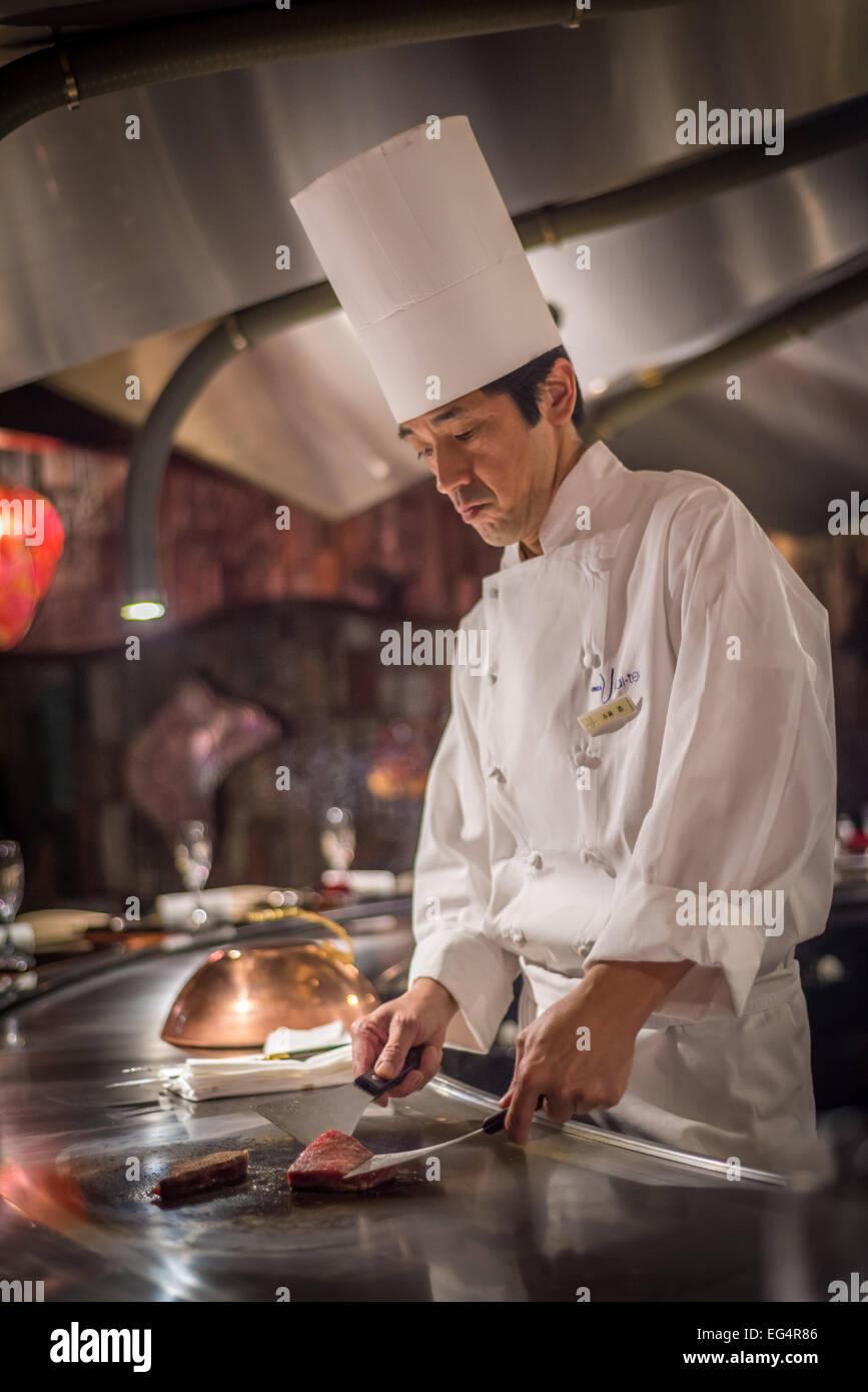 TOKYO, JAPAN - November, 30, 2014: Chef cooking wagyu beef in Japanese teppanyaki restaurant, Tokyo - Stock Image