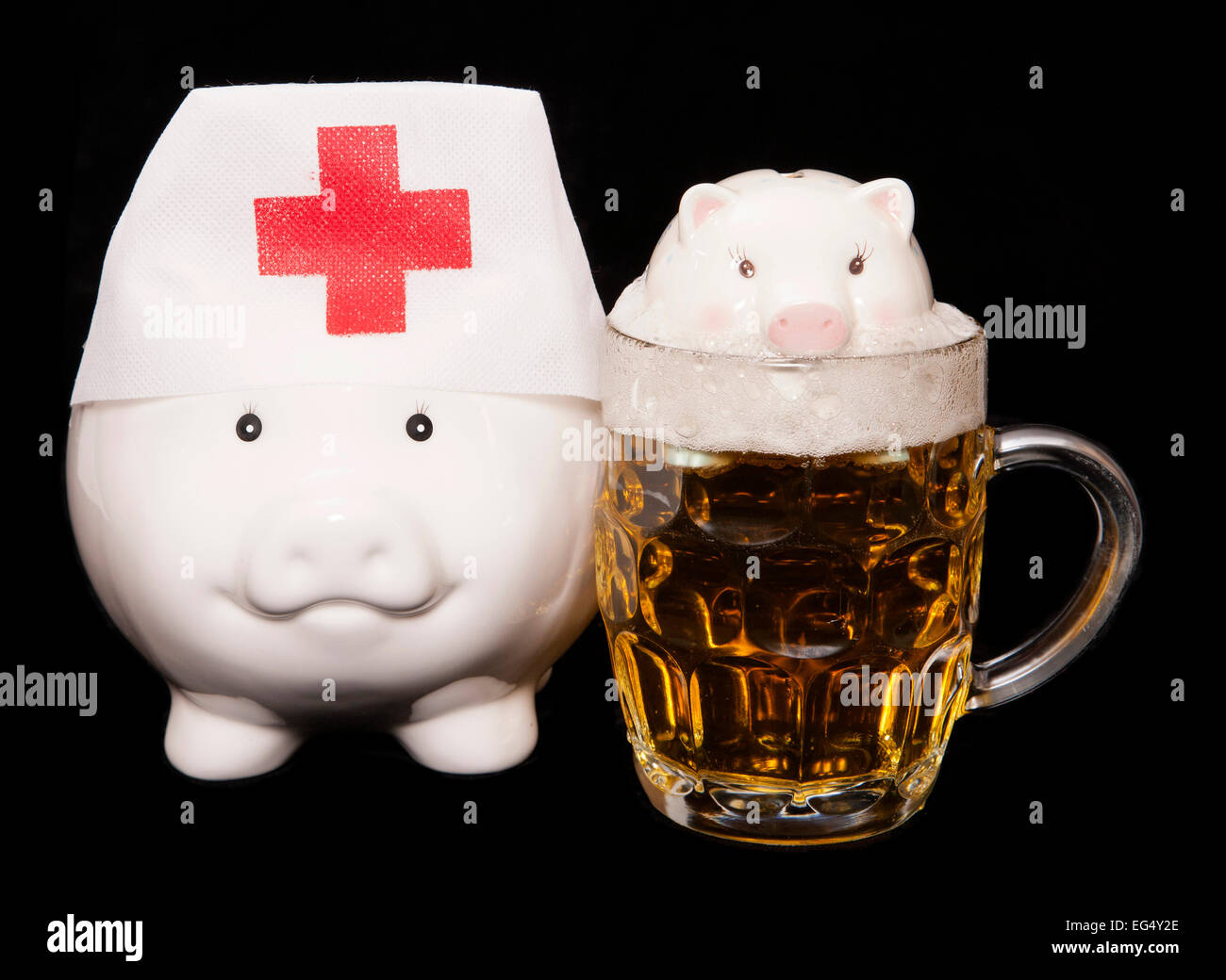drowning in debt from drinking piggy bank cutout - Stock Image