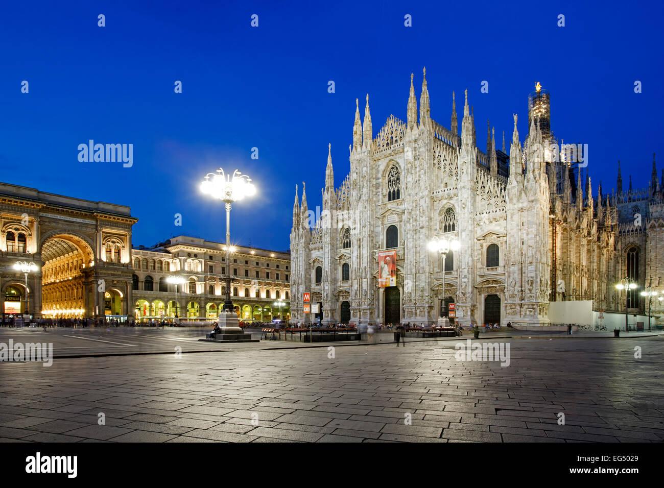 Galleria Vittorio Emanuele (left), and Milan Cathedral (Duomo di Milano) (right), Duomo Square, Milan, Italy - Stock Image