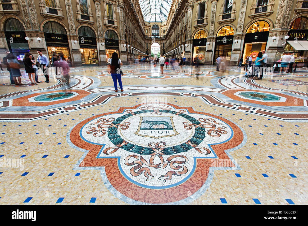 Mosaic floor, shops and shoppers, Galleria Vittorio Emanuele, Milan, Italy - Stock Image