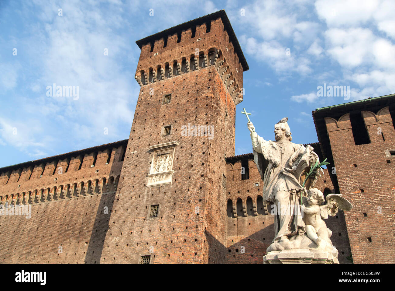 Statue of San Giovanni Nepomuceno (protector of soldiers), by Giovanni Dugnan, and tower, Sforza Castle, Milan, - Stock Image