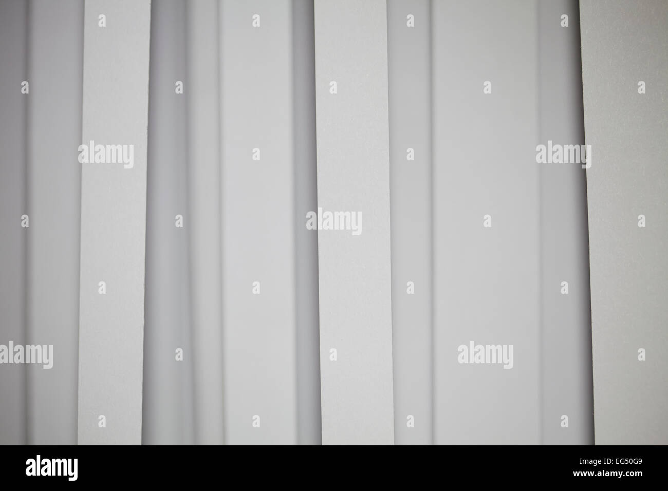 Minimal background made from a vertical white strip pattern - Stock Image