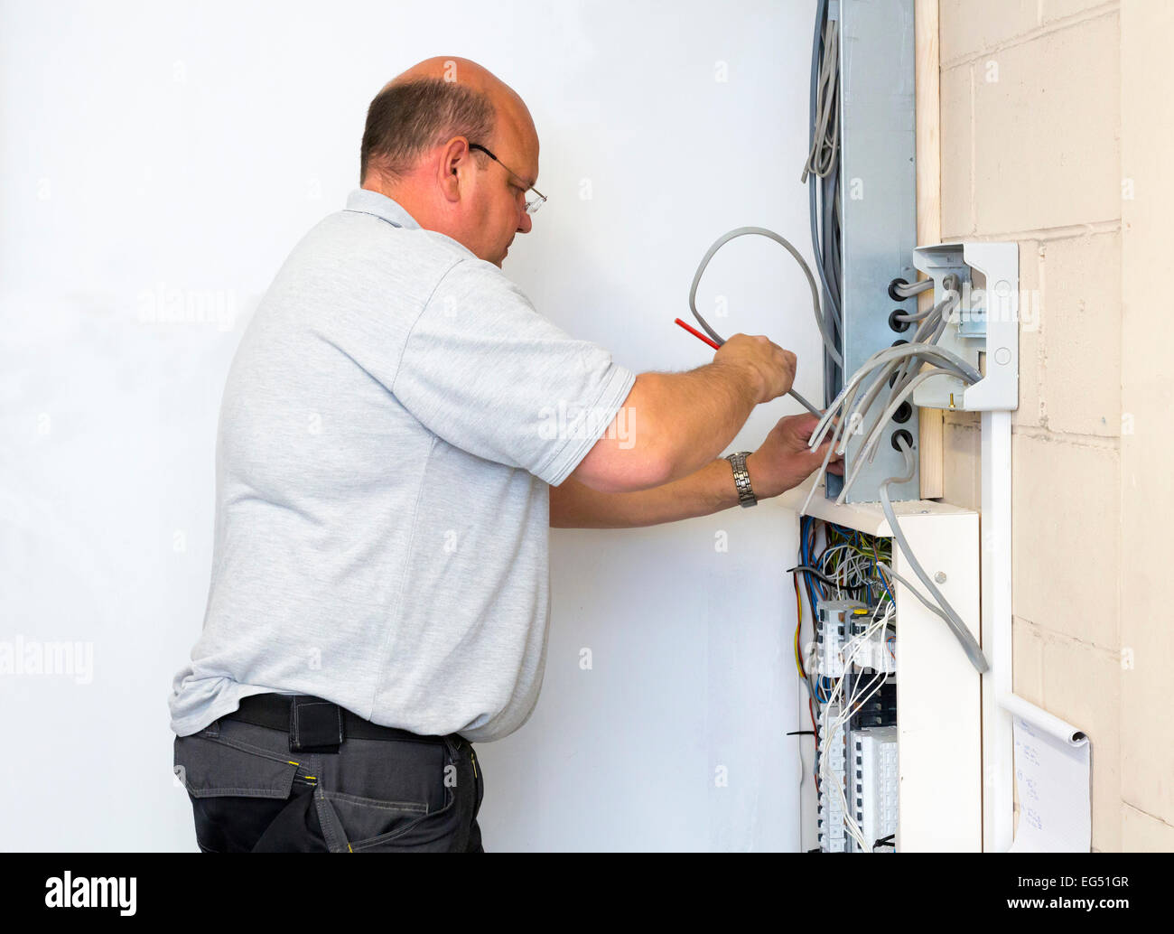 Amazing Electrician Doing Electrical Wiring Work Stock Photo 78786983 Alamy Wiring Database Ioscogelartorg