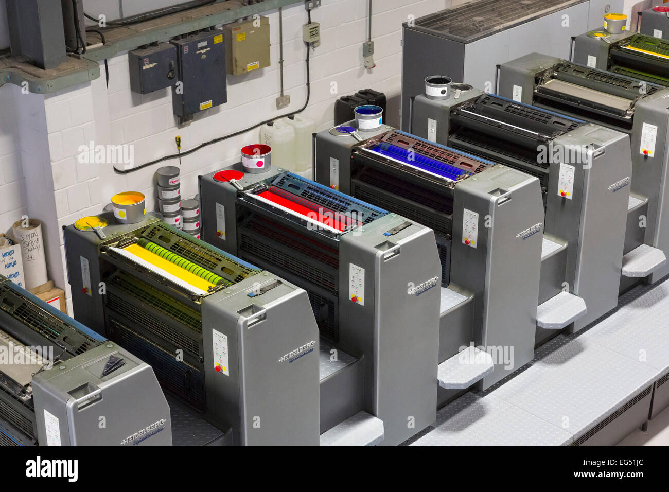 Heidelberg Speedmaster ten colour printing press with CMYK inks - Stock Image