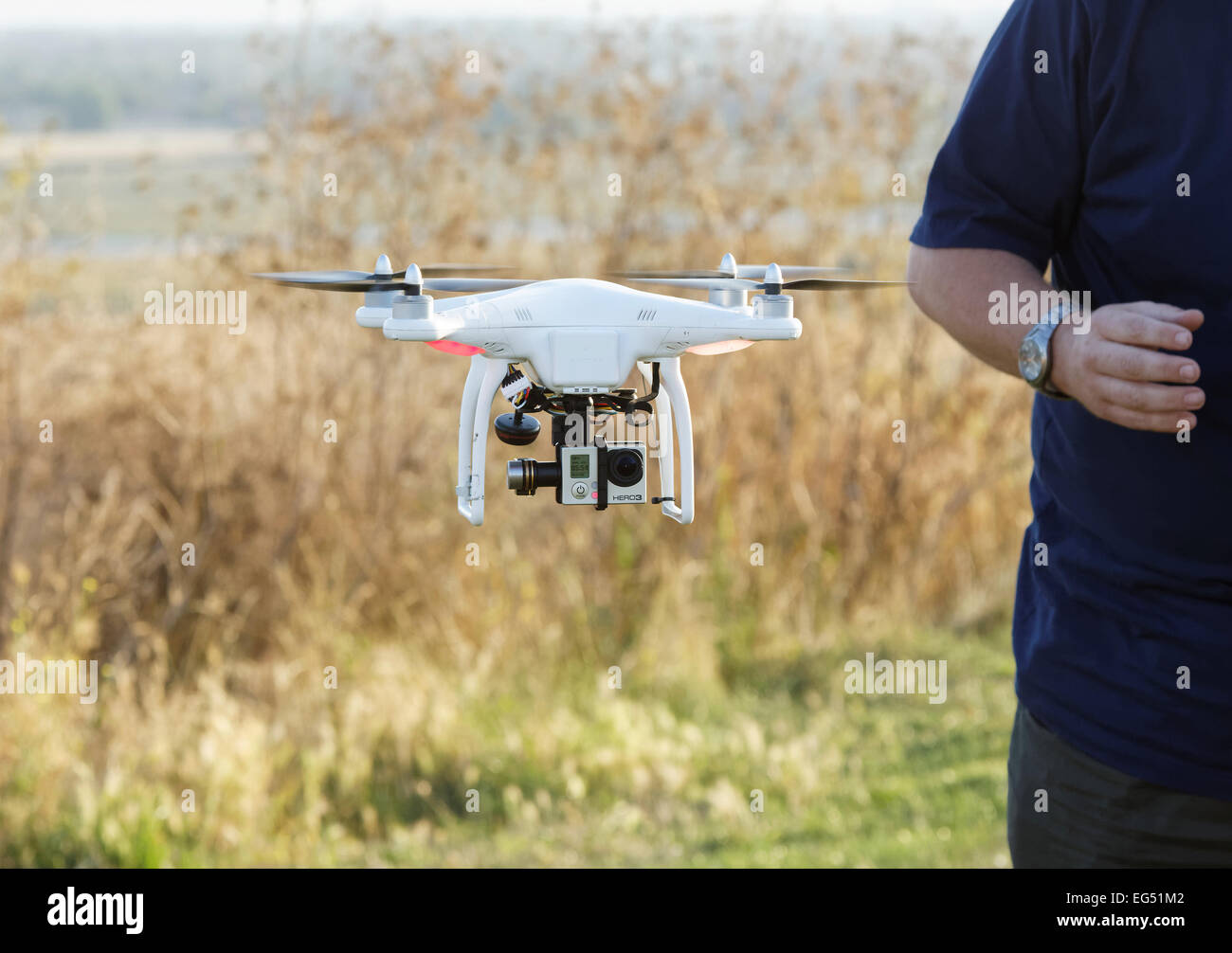 small drone / multicoptor flying with GoPro video camera - Stock Image