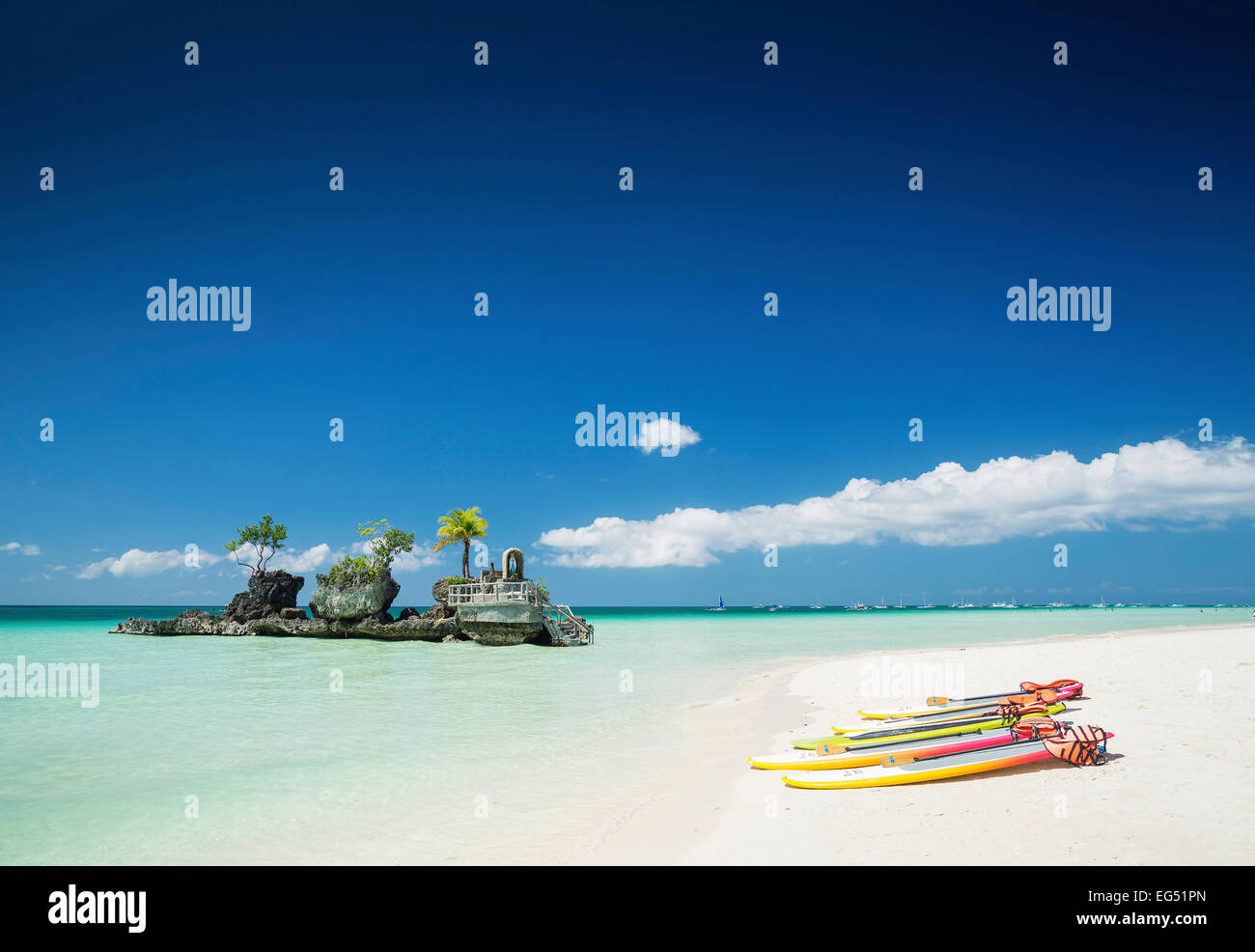 white beach and christian shrine and paddle boats on boracay tropical island in philippines asia - Stock Image