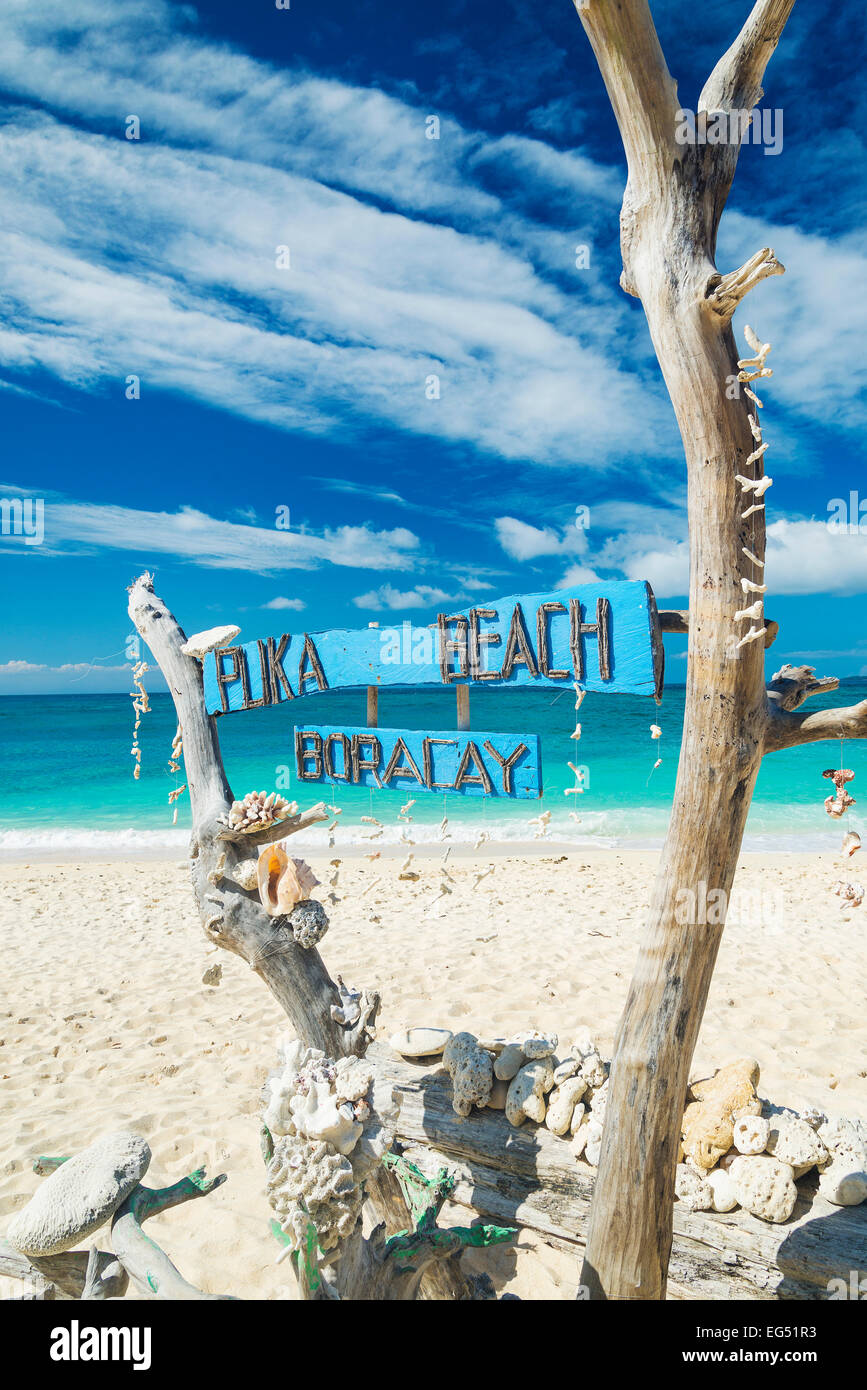 puka beach wooden sign in boracay island philippines - Stock Image