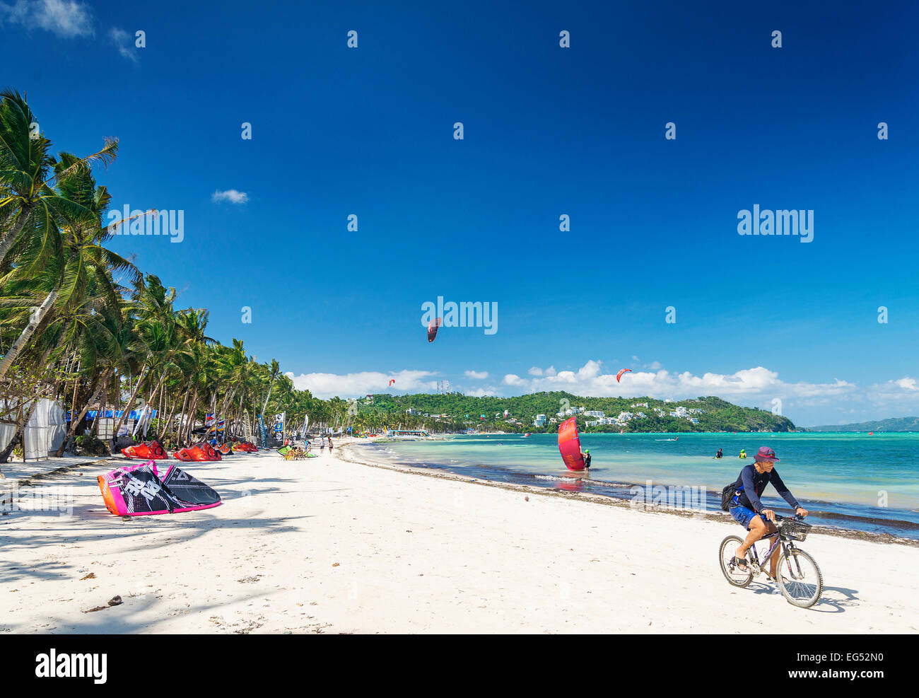 cycling and kitesurfing beach sports in boracay tropical island philippines - Stock Image