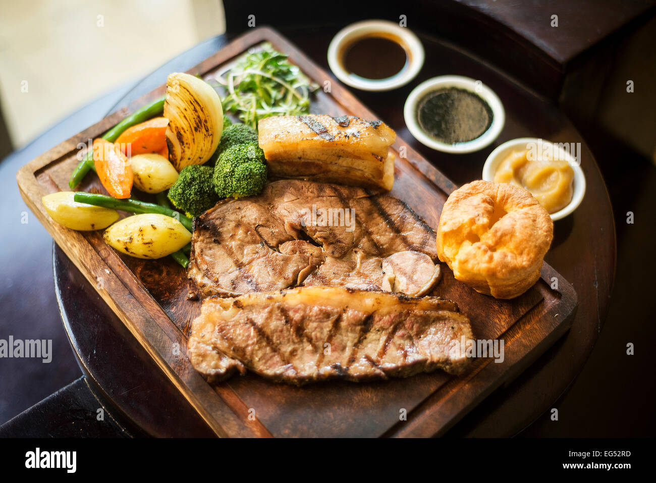 traditional english food sunday roast lunch in cozy restaurant pub - Stock Image