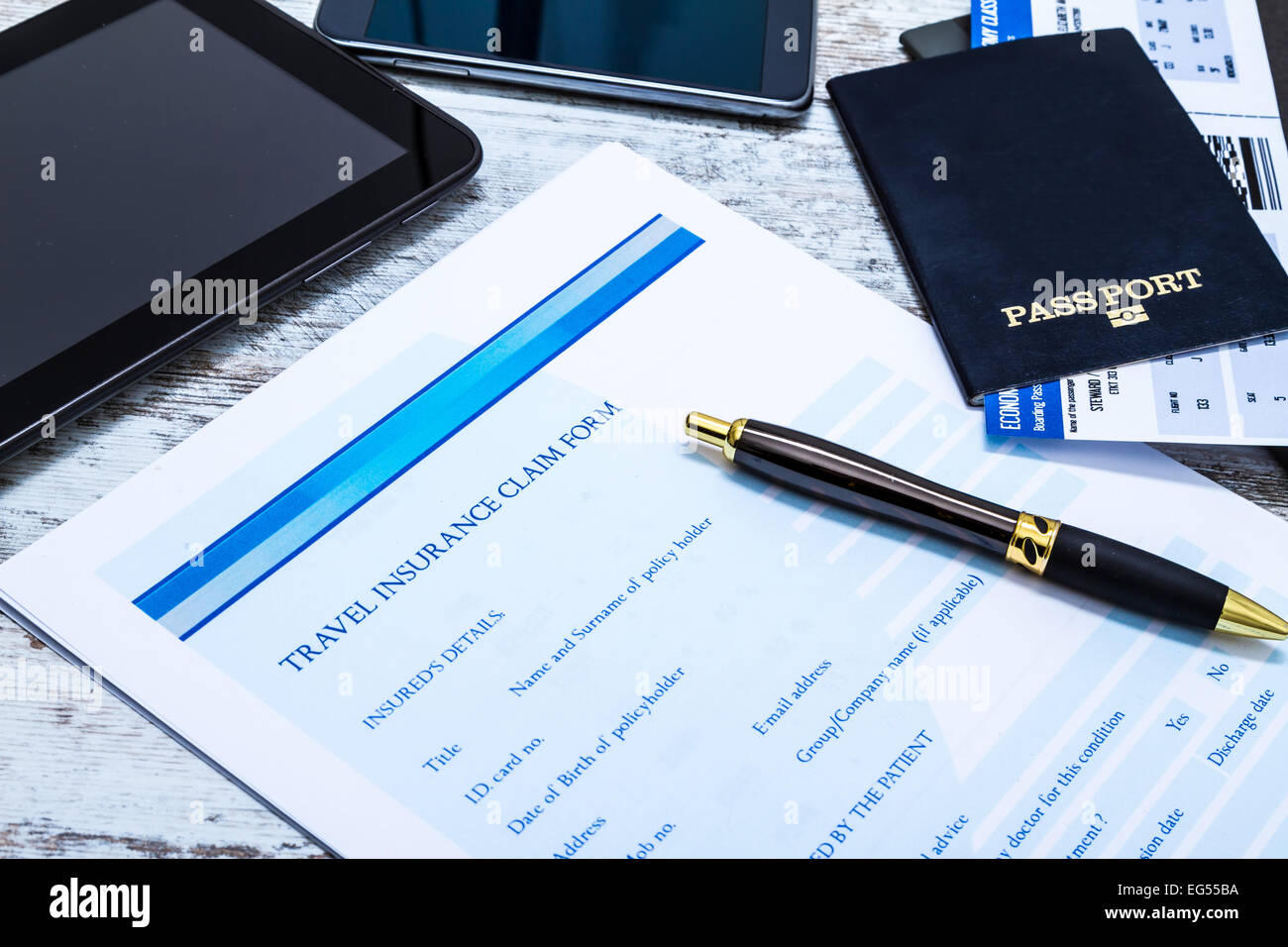 Travel insurance application form with a boarding pass and a passport Stock Photo