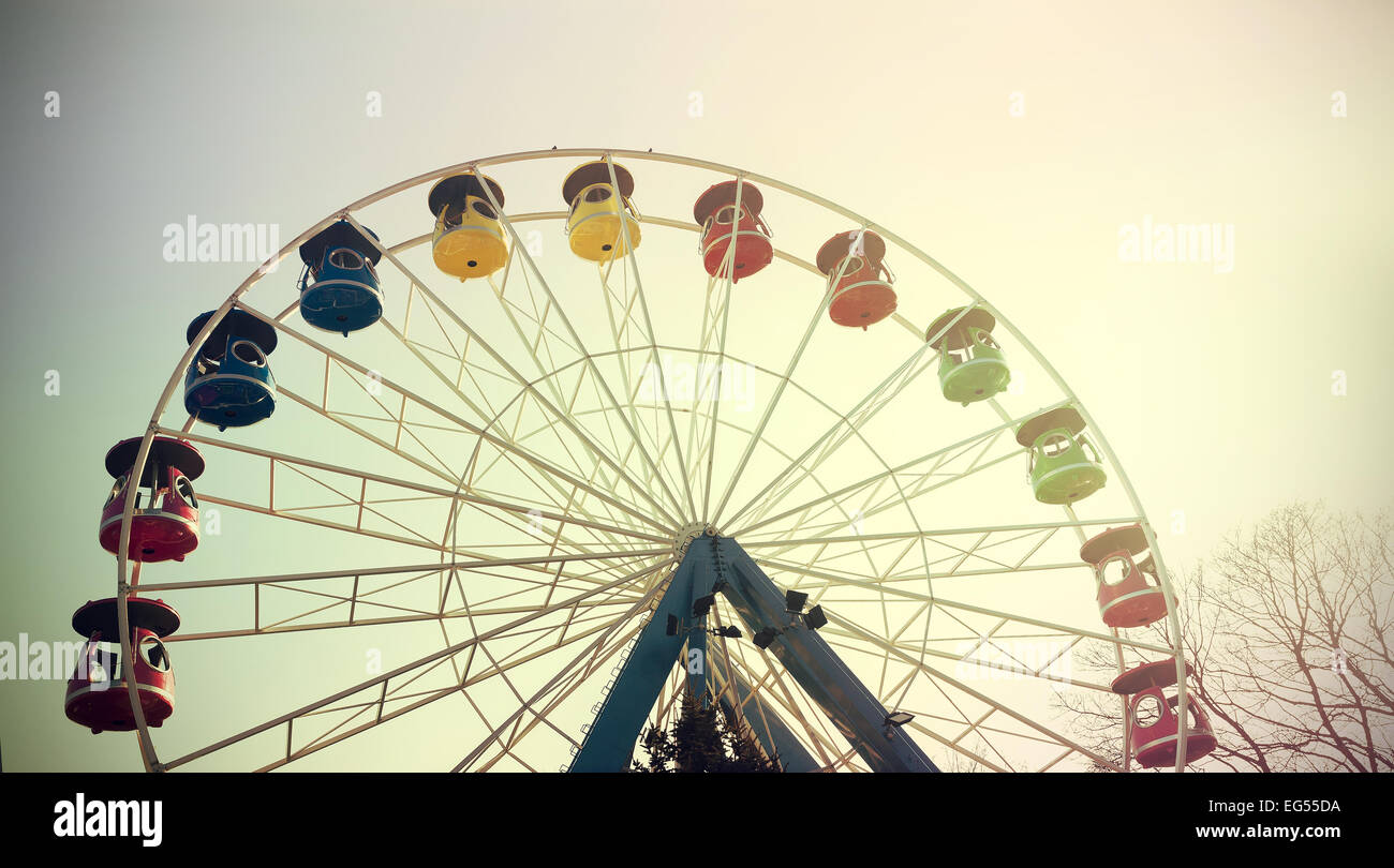 Retro vintage filtered picture of a ferris wheel. Stock Photo