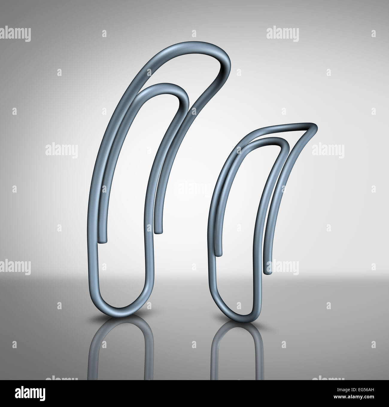Office bullying and bullies in the workplace concept as two paperclips with one intimidating another as a corporate - Stock Image