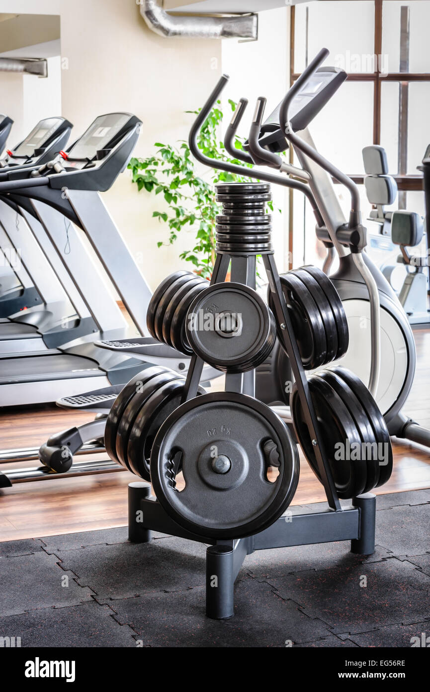 Barbell plates rack in the gym - Stock Image