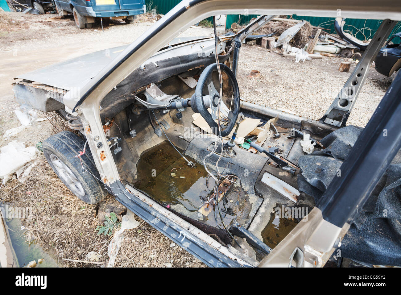 old disassembled car at an automobile country yard - Stock Image