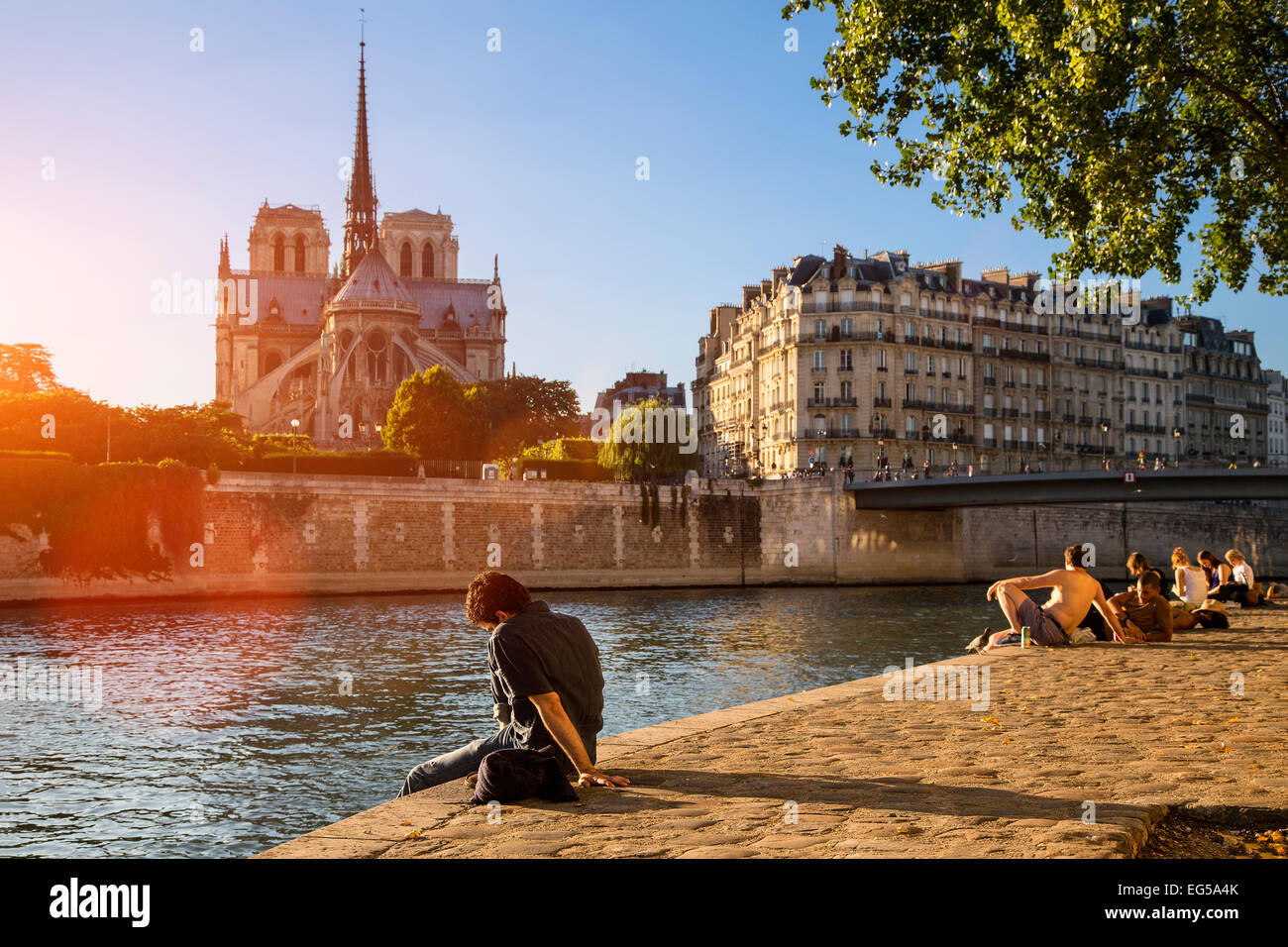 Paris, people relaxing along Seine river - Stock Image
