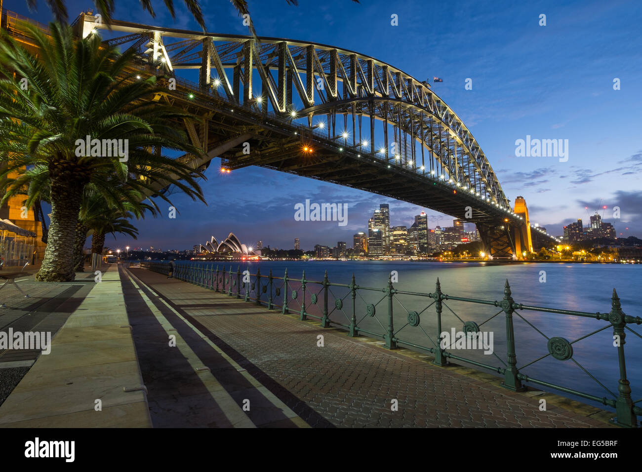 SYDNEY, AUSTRALIA- JANUARY 5, 2015: The iconic Sydney Harbour Bridge with Sydney Opera House in the background at - Stock Image