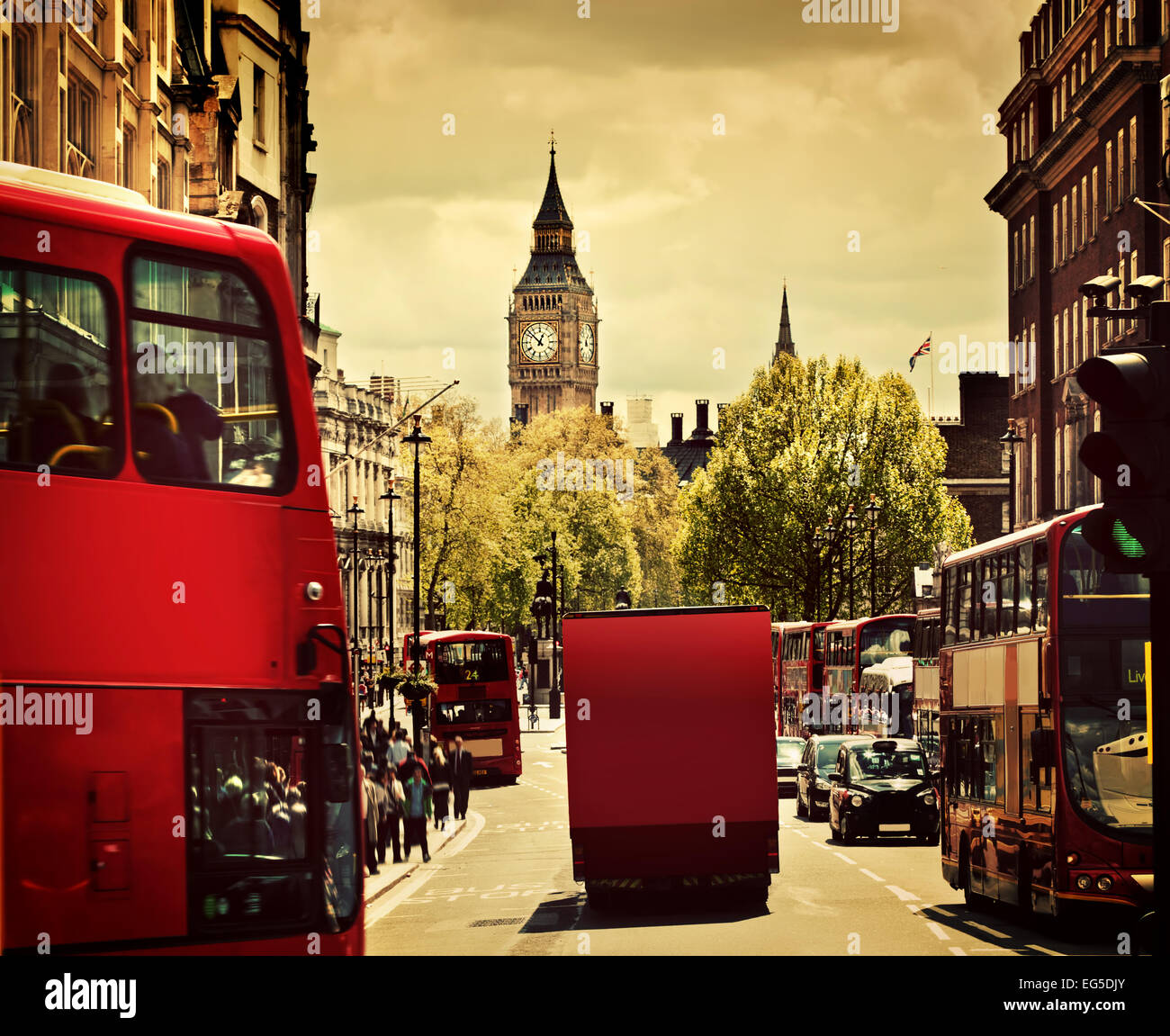 Busy street of London, England, the UK. Red buses, Big Ben in the background. - Stock Image
