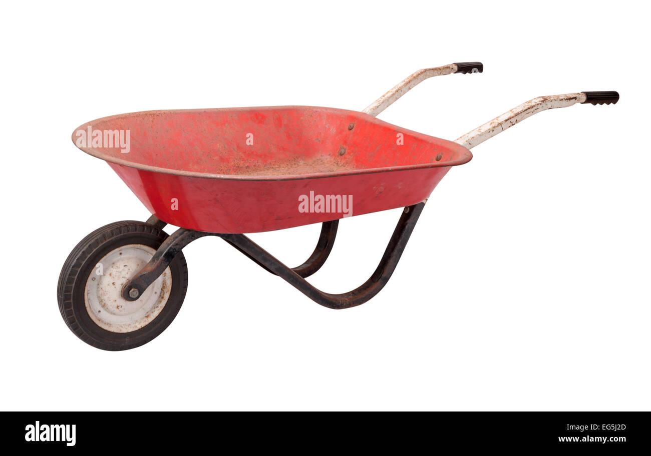 Rusty Child's Wheelbarrow isolated on white. - Stock Image