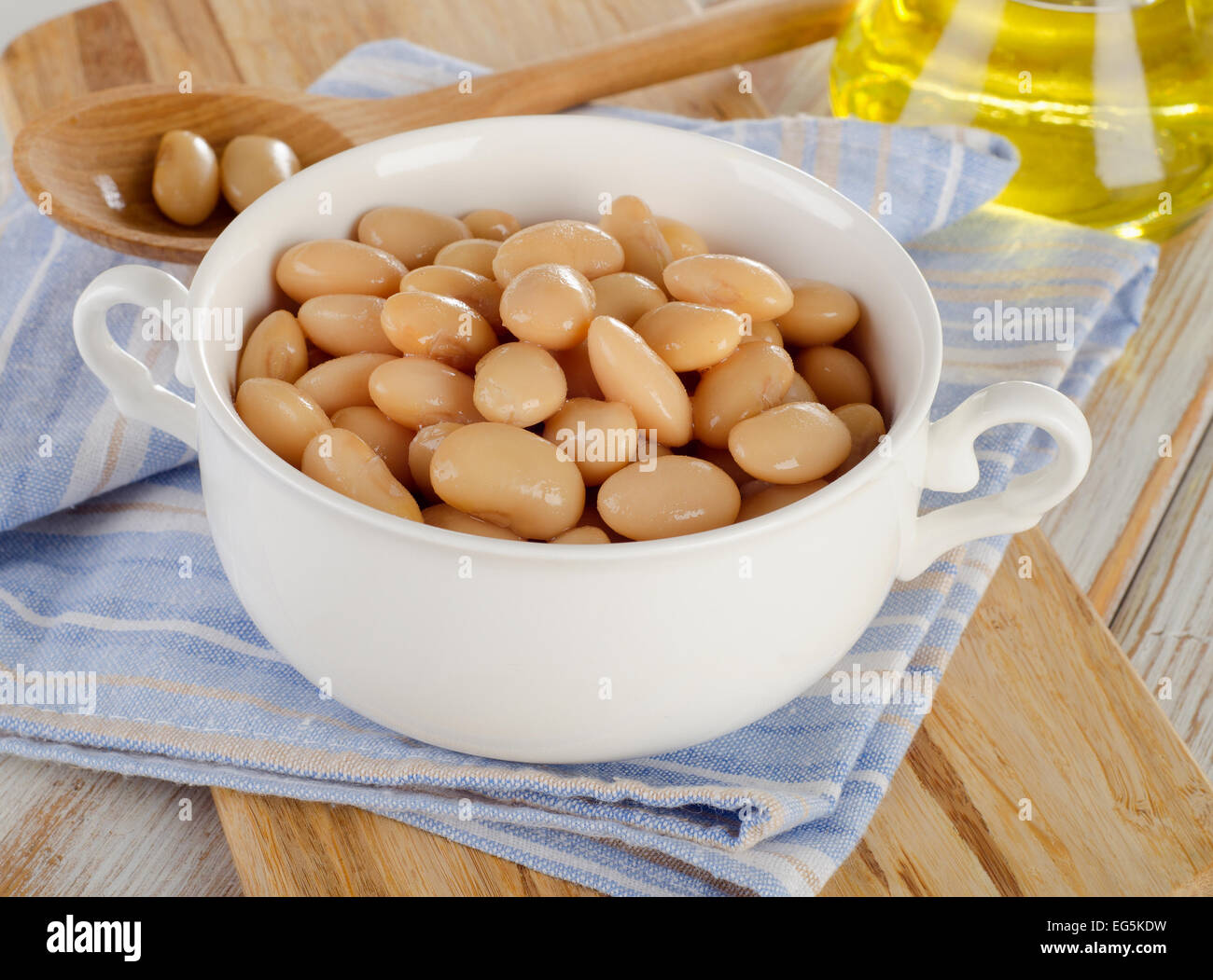 White beans on  wooden background. Selective focus Stock Photo