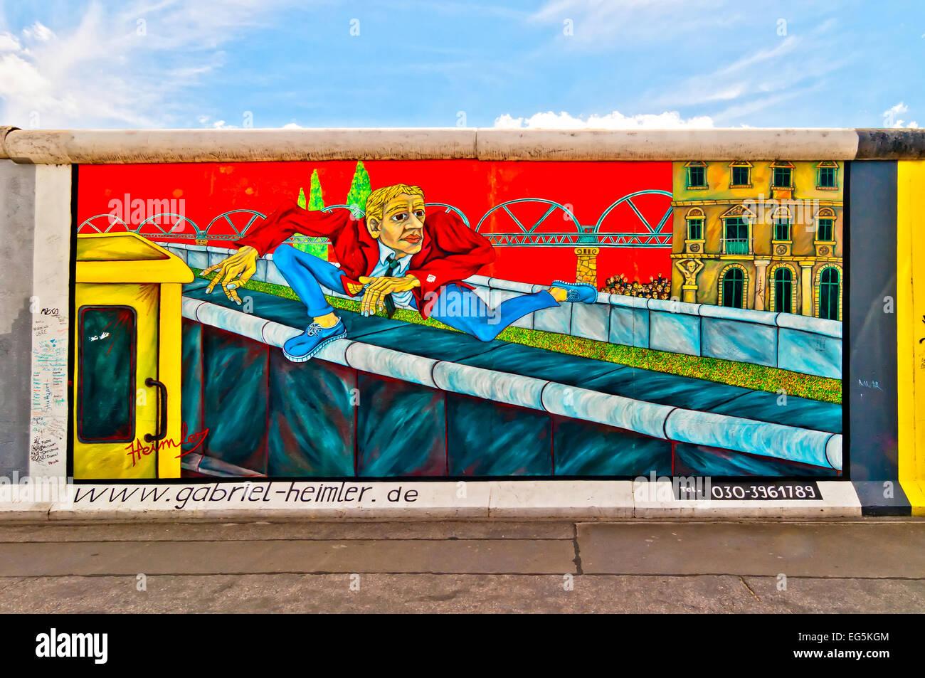 BERLIN, GERMANY - JUNE 10, 2013:  memorable segment of the Wall with work of artist Gabriel Heimler in Berlin, Germany. - Stock Image
