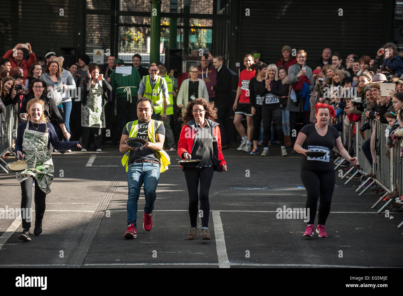 London, UK. 17th February, 2015.  The Better Bankside Annual Charity Pancake Race at Borough Market.  Credit:  Gordon - Stock Image