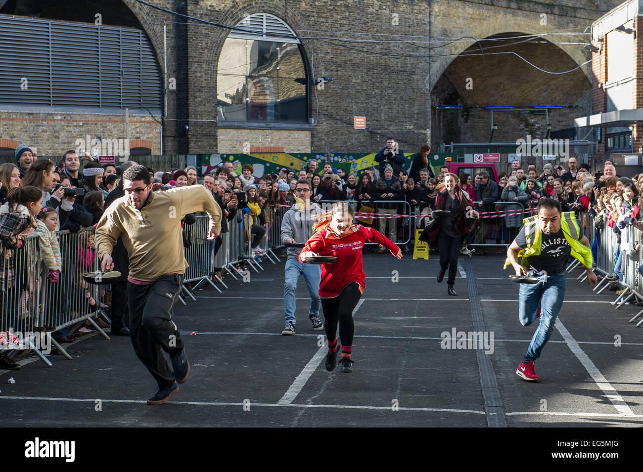 London, UK. 17th February, 2015.  The Better Bankside Annual Charity Pancake Race at Borough Market.  Credit:  Gordon - Stock Image