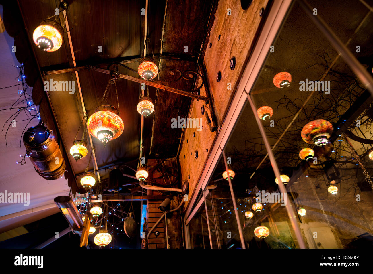 Colorful Turkish lights hang anove a restaurant in Istanbul, Turkey. - Stock Image