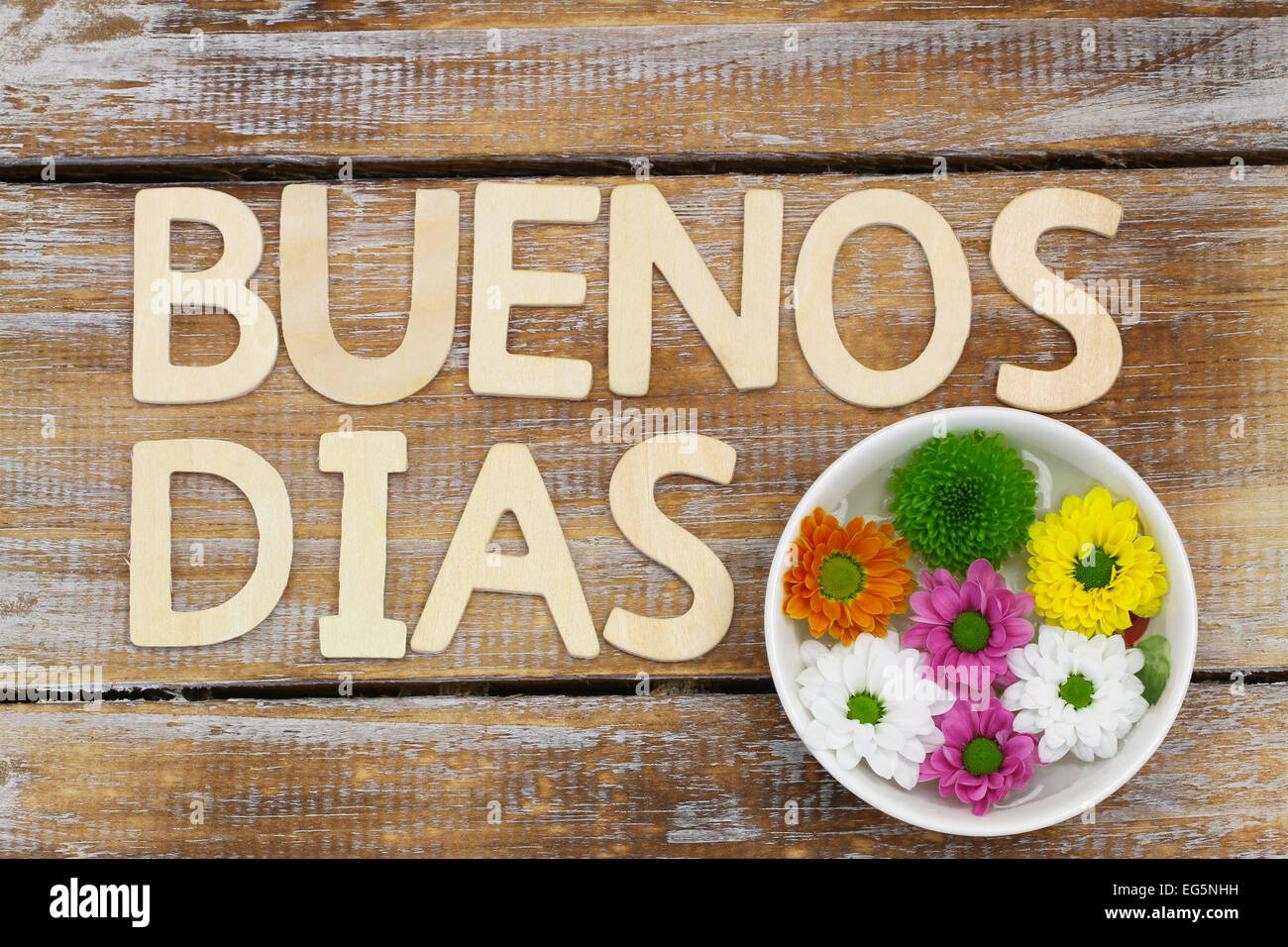Buenos Dias Good Morning In Spanish Written With Wooden Letters And Santini Flowers
