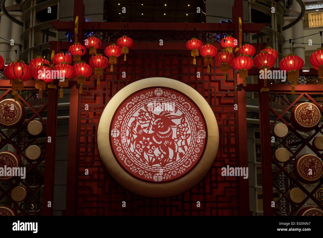 Red lanterns and other decorations in a shopping mall to celebrate the Chinese new year of the goat, Kuala Lumpur, - Stock Image