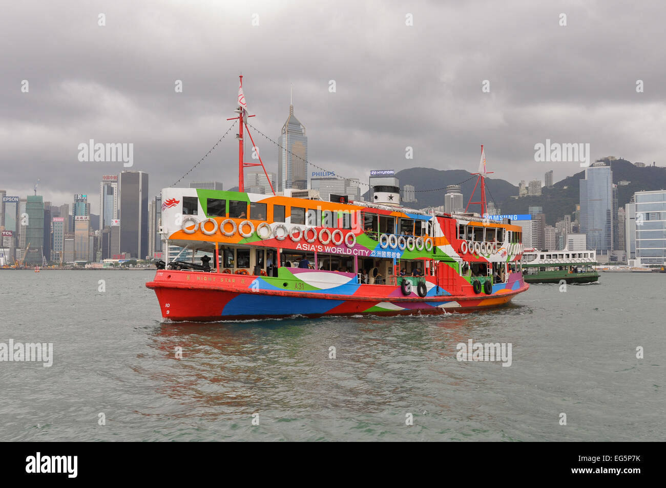 'Night Star' - One of twelve ferries operating as The Star Ferry across Victoria Harbour between Hong Kong - Stock Image