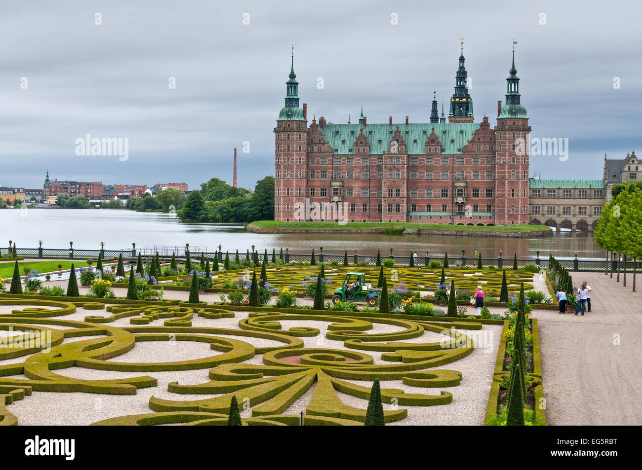 Tourists visiting the Frederiksborg palace and the baroque gardens in nasty weather. - Stock Image