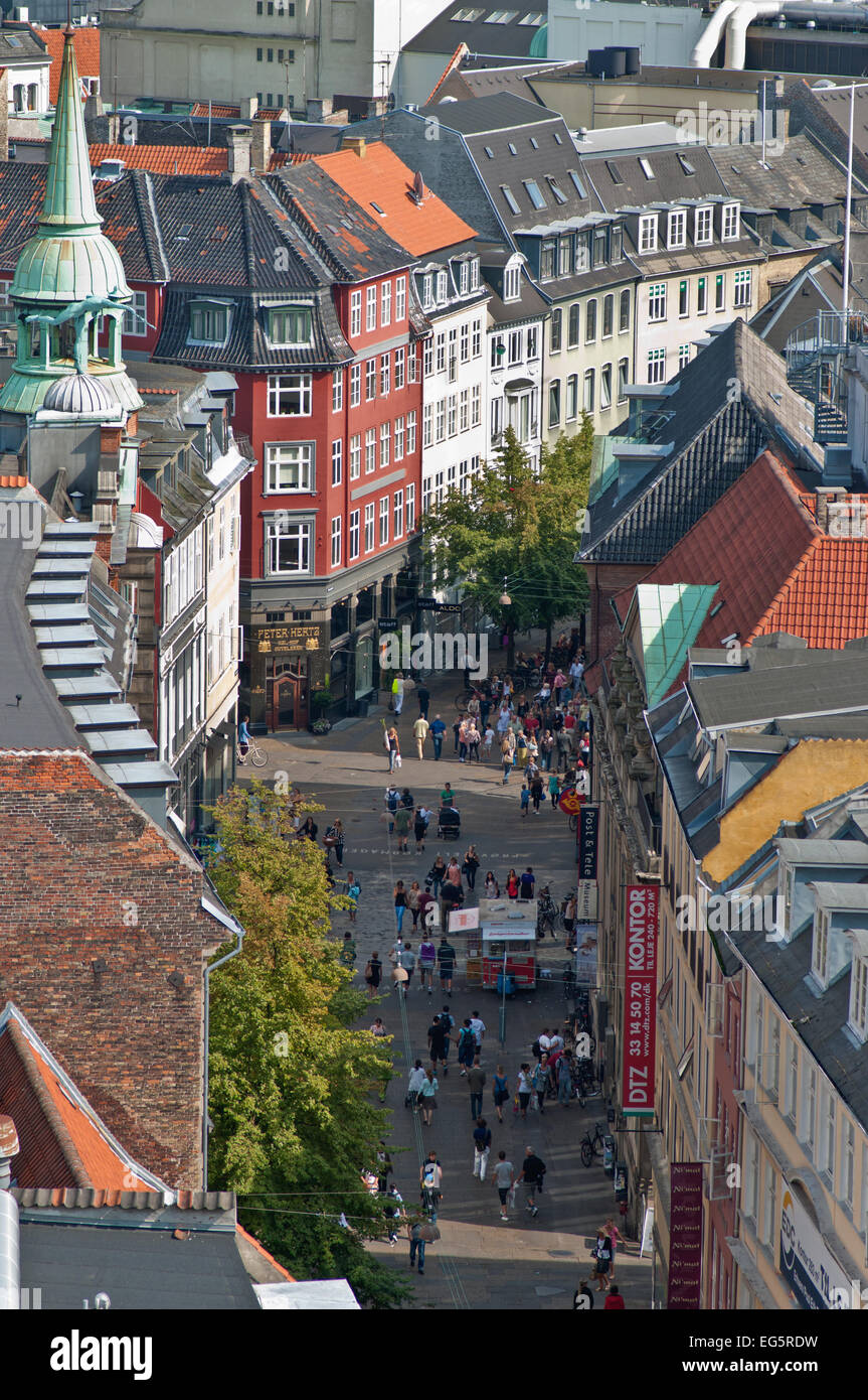 People strolling through the pedestrianized streets of Copenhagen's central shopping district - Stock Image