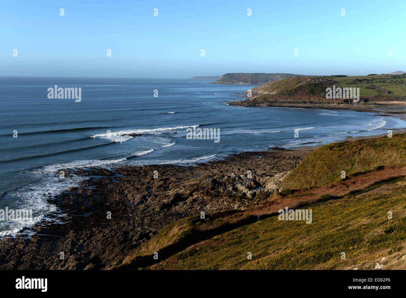Lines of swell peel into the bay at Langland a short coast walk from Caswell , Gower, Wales Stock Photo