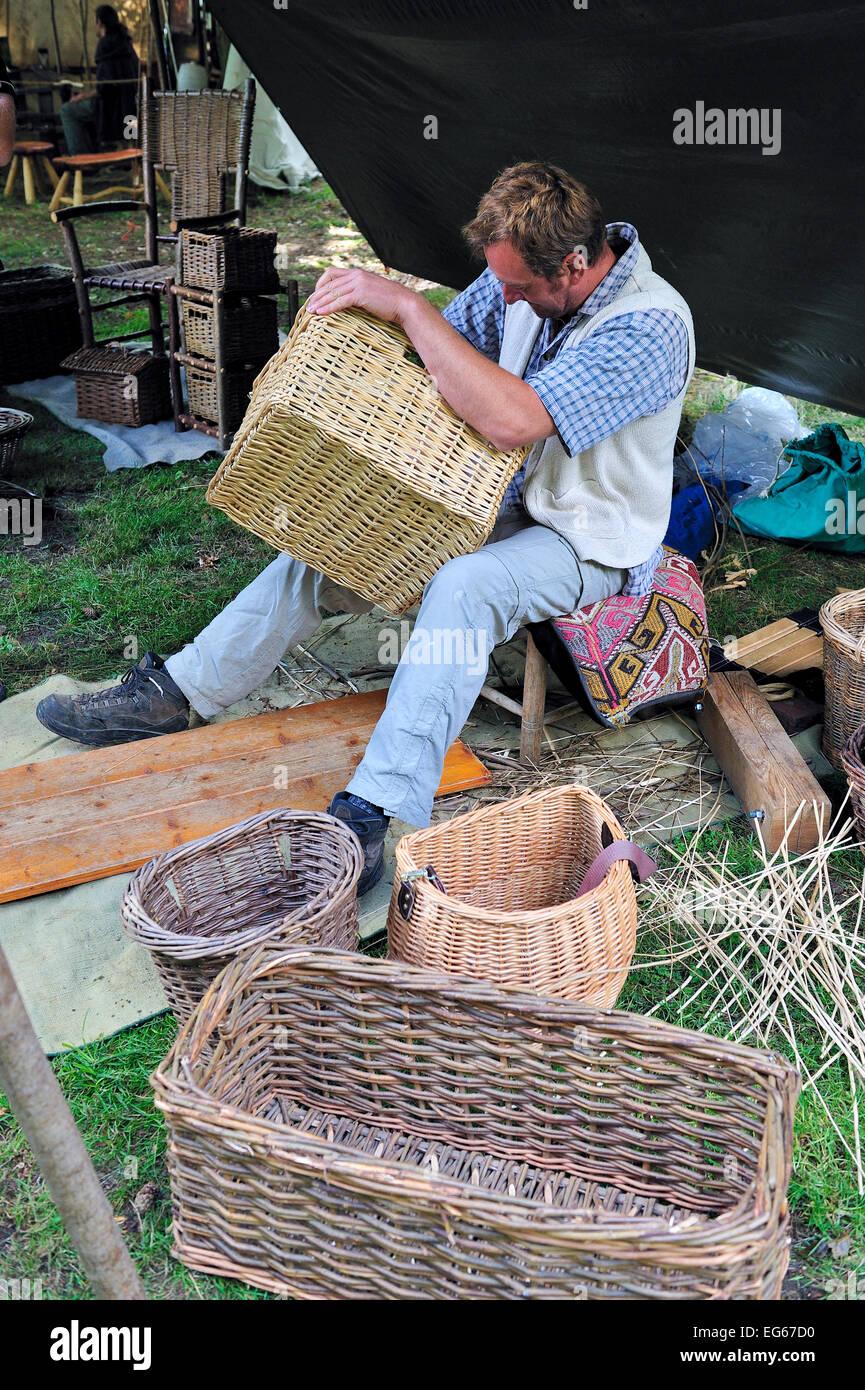 Demonstration of the craft of basket making weaving - Stock Image
