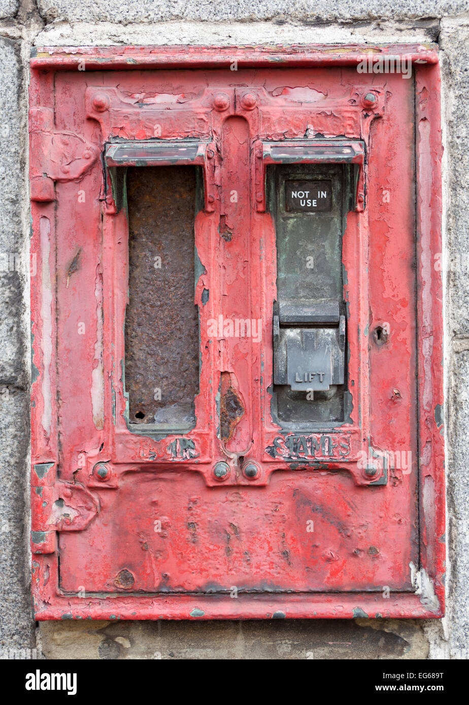 Closeup of Old Stamp Issuing Machine in Wall outside newsagents shop in Aberdeen - Stock Image