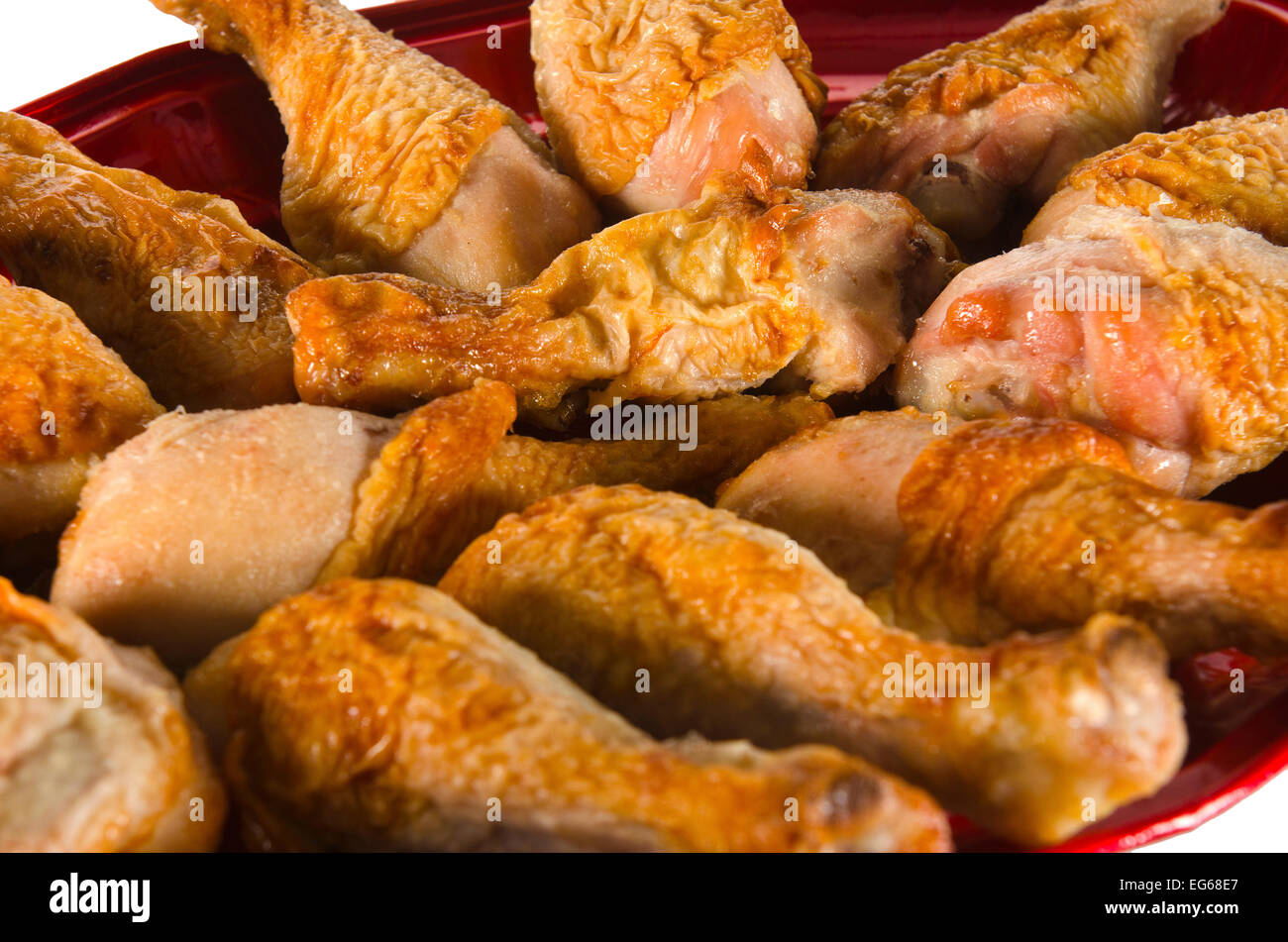 a plate of party chicken drumsticks - Stock Image