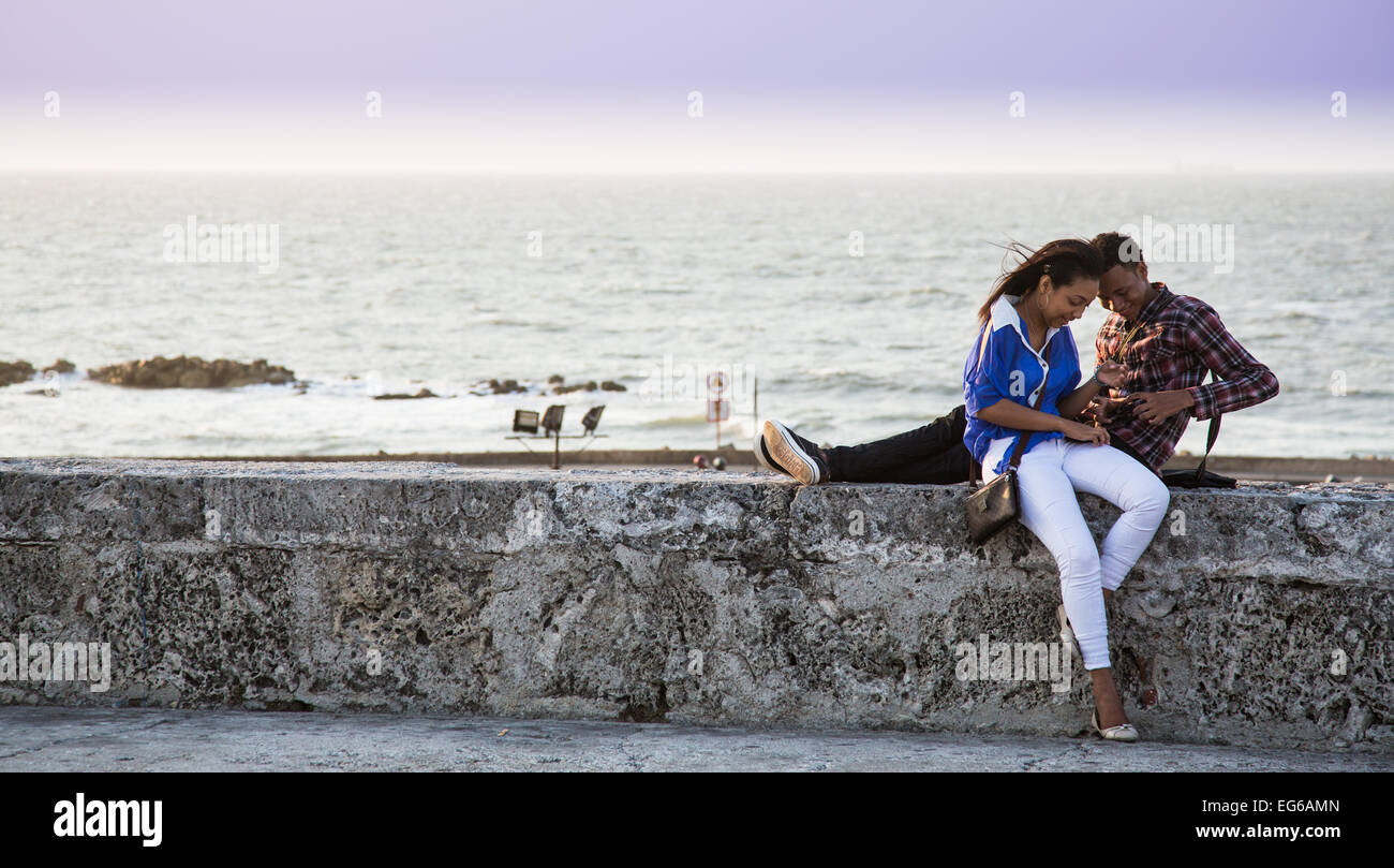 Cartagena, Colombia - February, 23, 2014 - Teen couple shares an intimate  moment on the old city walls surrounding Cartagena.