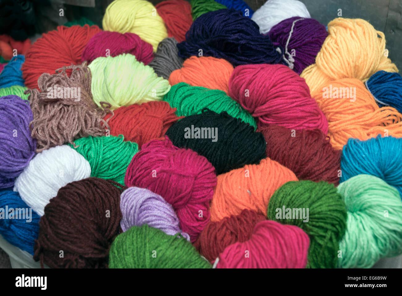Multi-colored skeins of wool, Olgii main market, Western Mongolia - Stock Image