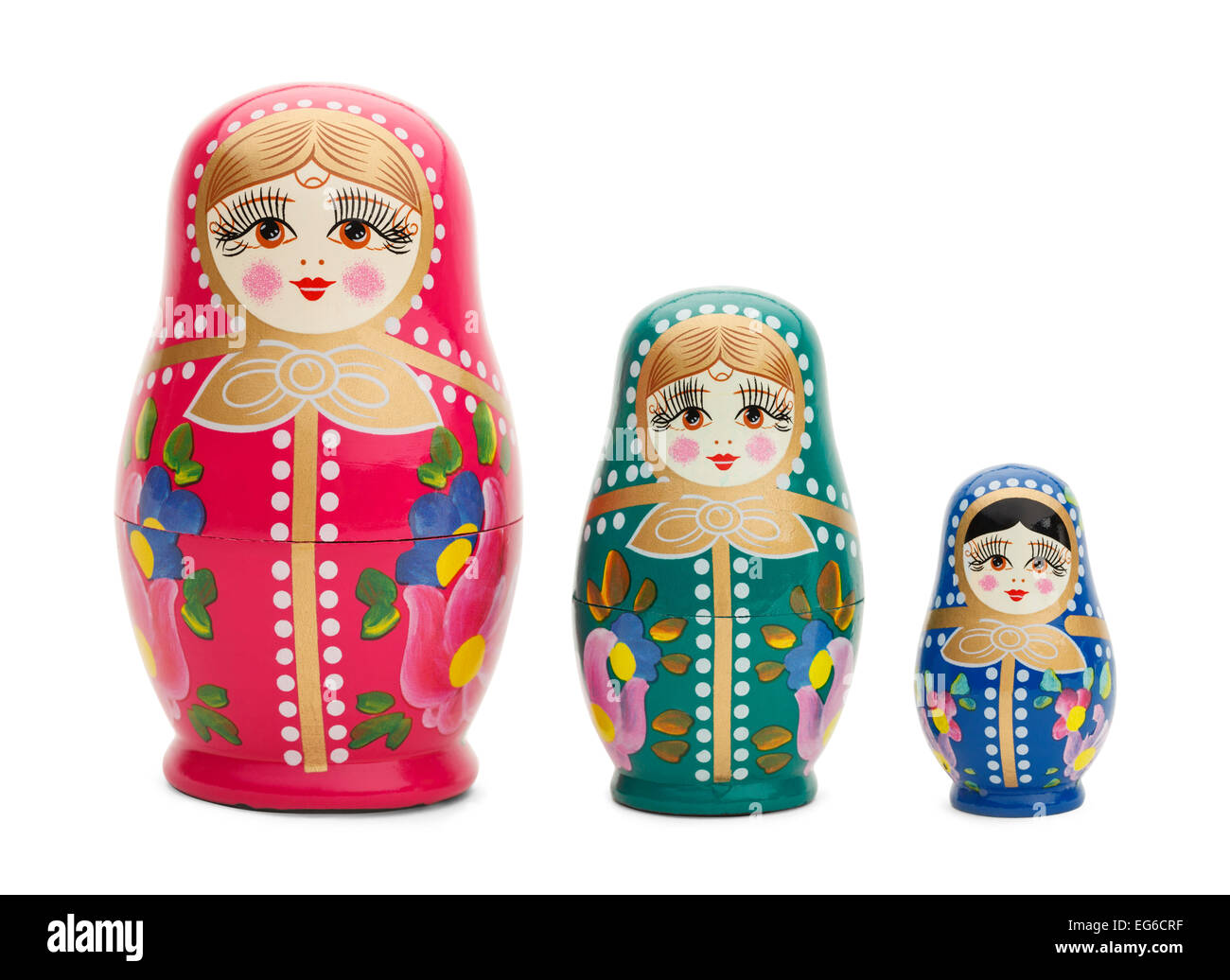 Three Traditional Russian Wood Dolls Isolated on White Background. - Stock Image