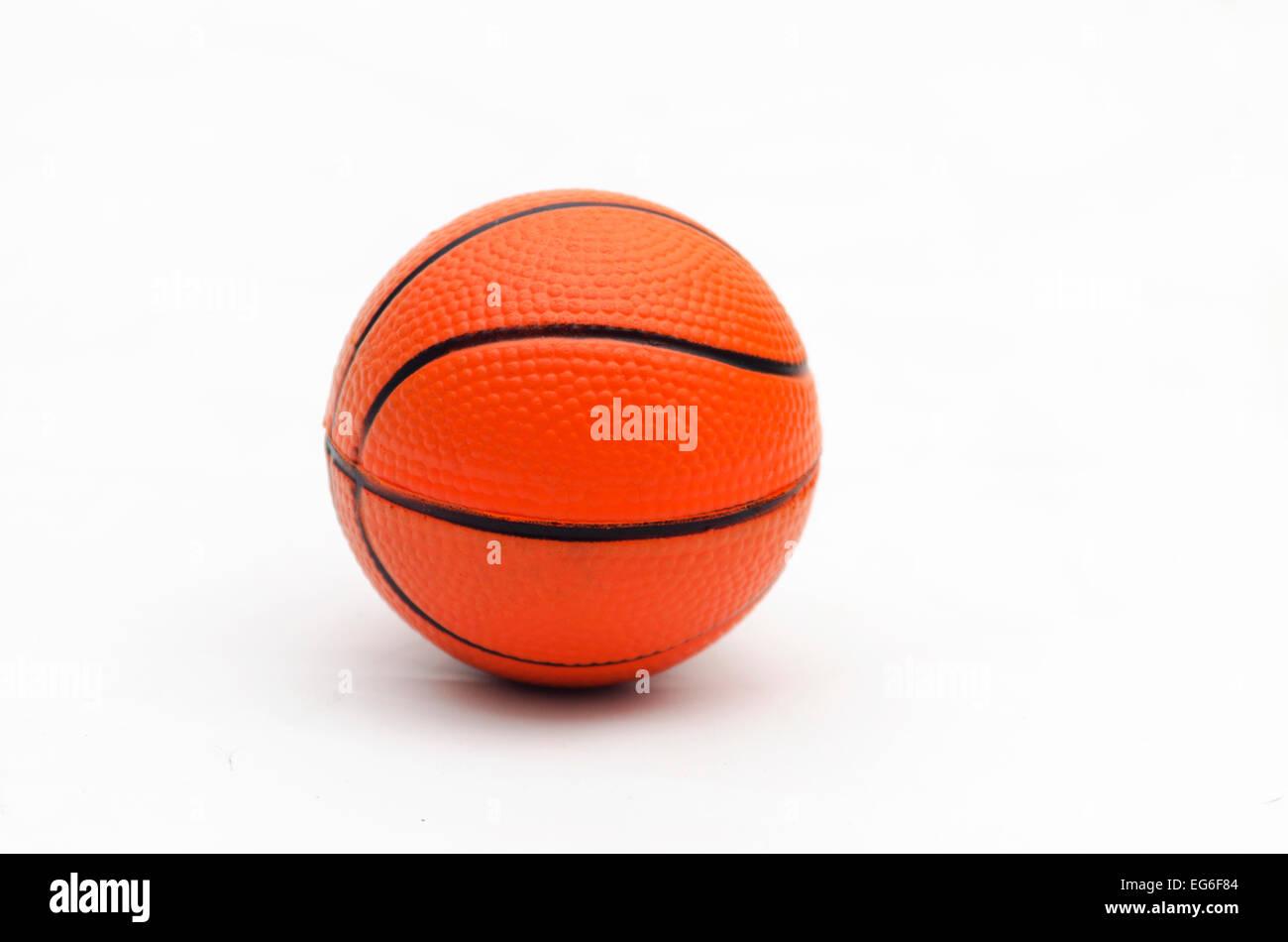 orange basket ball on white background - Stock Image