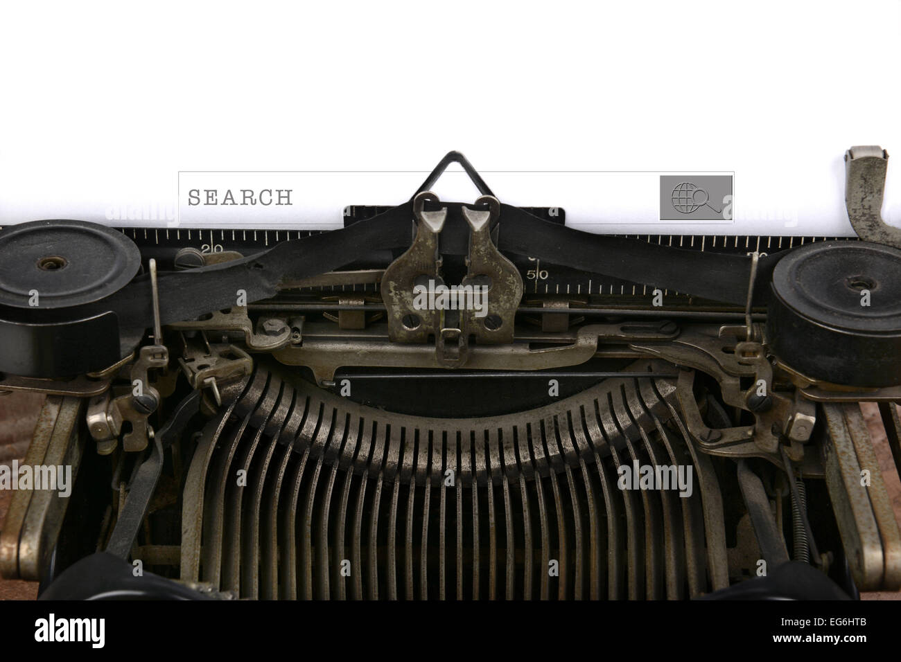 An old fashioned typewriter with a search box. Closeup of the antique machines ribbon and carriage with a modern Stock Photo