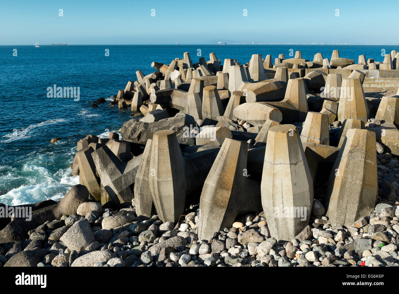 Defense concrete blocks at a pier, Cape Town, South Africa - Stock Image