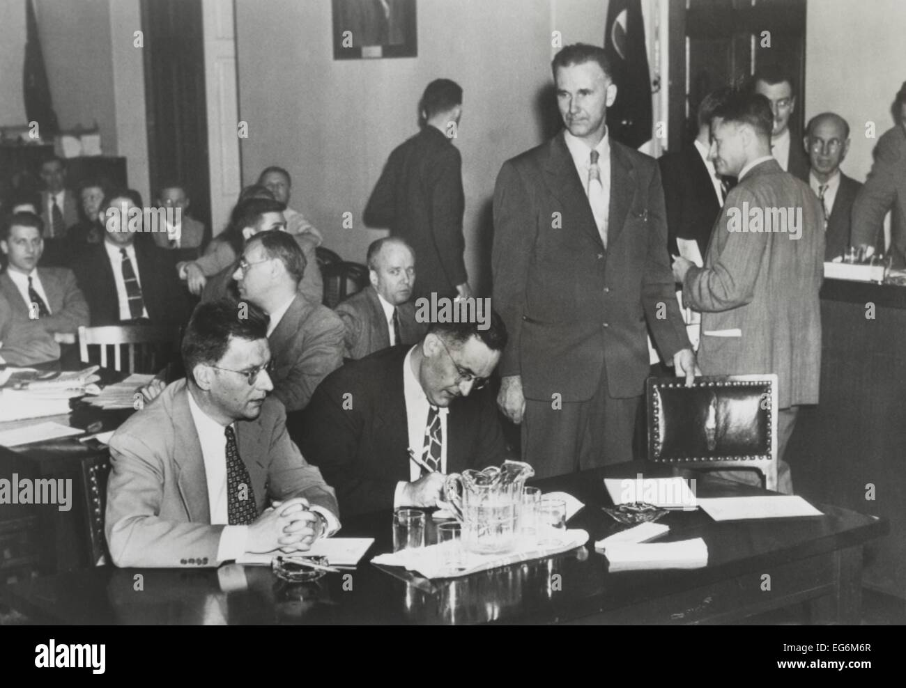 Paul Crouch (standing), an ex-Communist, testified against Clarence Hiskey (left). Hiskey was wartime atomic scientist,Stock Photo