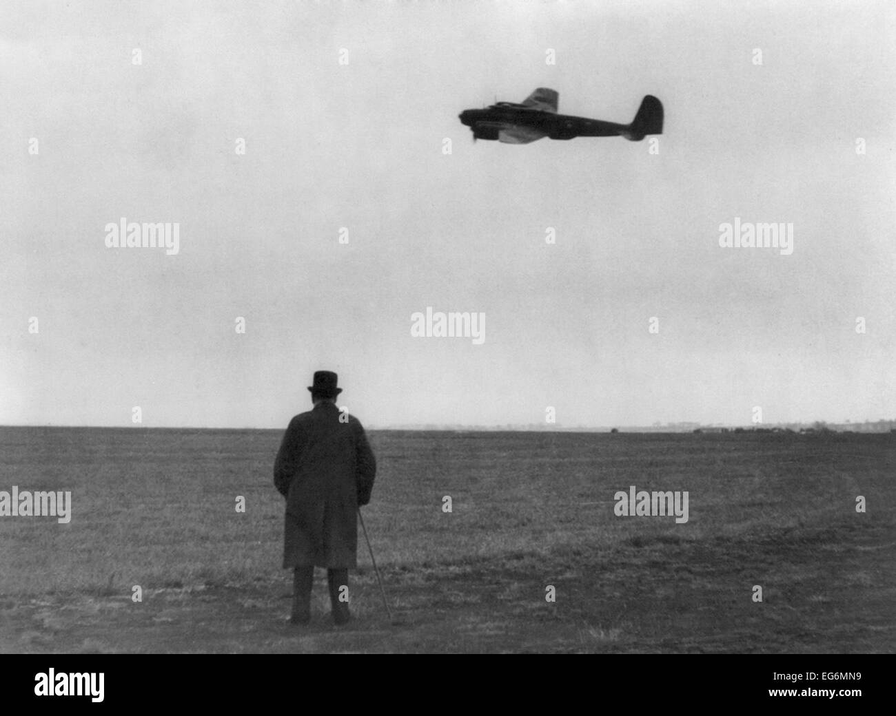 Winston Churchill, photographed from behind, watching B-17 'Flying Fortress' in flight. July 1940. World War 2. Stock Photo