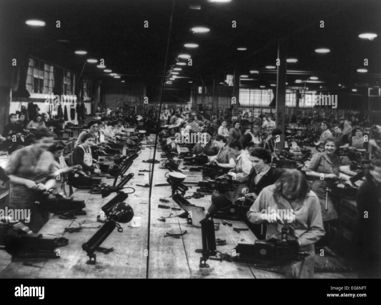 Scores of British women perform light bench work at a small arms factory. Ca. 1939-45. World War 2. (BSLOC_2014 - Stock Image